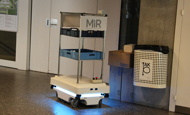 MiR100 driving away from the elevator